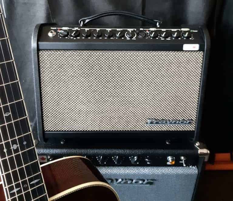 Traynor AM Mini black amp with acoustic guitar