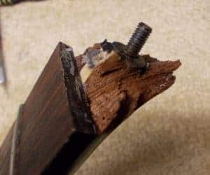 broken headstock with shattered wood and bolt