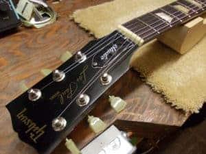 headstock of repaired les paul studio guitar