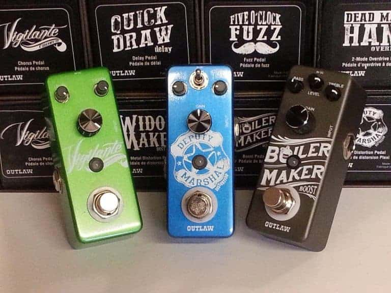 three outlaw effects pedals in green, blue and black