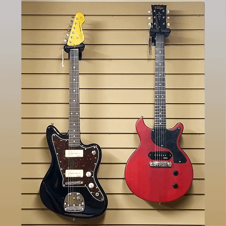 Vintage V65 and V130 ReIssued Series Electric Guitars hanging on wall