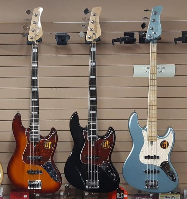Sire basses hanging on wall
